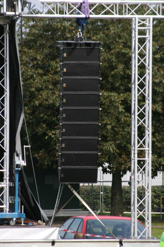 Crowpoint Festival.  A close up of 8 x Martin Audio W8LM Line Array Elements + 1 W8LMD Downfill, hung from PA wings attached to the stage.